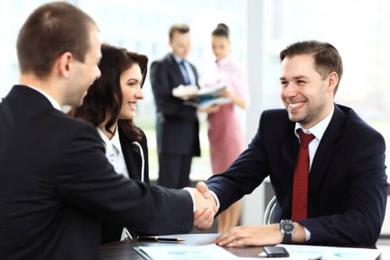 Accountant shaking hands with client